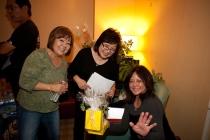 Janice (Muramoto) Chin, Cynthia (Sodetani) Iwai, and Linda (Higa) Nyman work on raffle prizes.