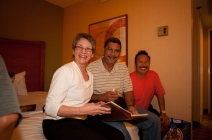Linda (Miller) Bruder, Sidney Medeiros, Stanley Reyes looking up someone in the Kaulana.